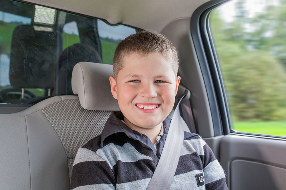 Child using a seatbelt